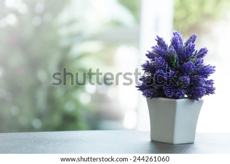 Bouquet of beautiful spring flowers of lilac in a vase - stock photo