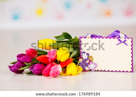 bouquet of beautiful tulips with a card. March 8, valentine's day, mother's day - stock photo
