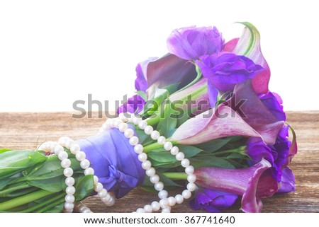 Bouquet of calla lilly and eustoma flowers  on wooden table border isolated on white background - stock photo