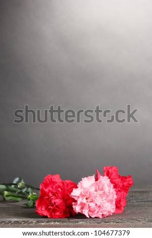 Bouquet of carnations on grey