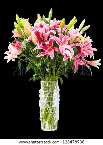 Bouquet of colorful lilies in vase isolated on black background.
