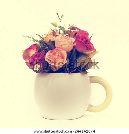Bouquet of colorful roses in white vase : vintage style and  filtered process - stock photo