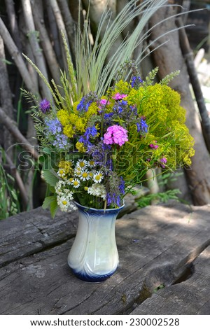 bouquet of colorful summer flowers in the countryside