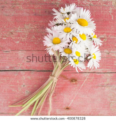 Bouquet of daisies on white wooden background - stock photo