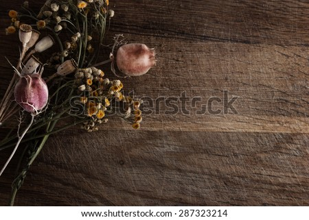 Bouquet of dried flowers on a wooden background.