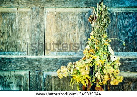 Bouquet of dry wild flowers on wooden background. Copy space - stock photo