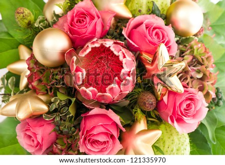 bouquet of exotic flower protea and fresh pink roses with golden christmas decoration - stock photo