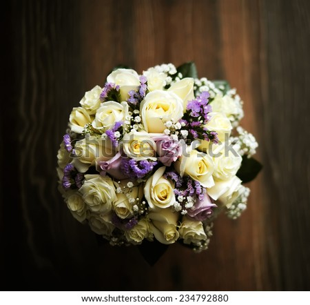 bouquet of fine flowers for wedding ceremony on a wooden table - stock photo