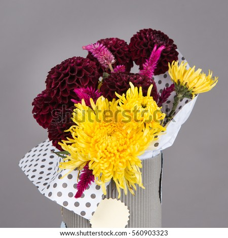Bouquet of flowers for children with red and yellow flowers