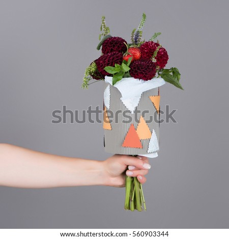 Bouquet of flowers for children with yellow flowers and strawberries