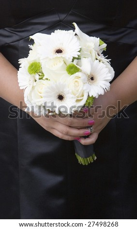 bouquet of flowers held by bridesmaid - stock photo
