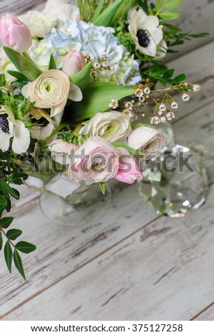 Bouquet of flowers in a glass vase - stock photo