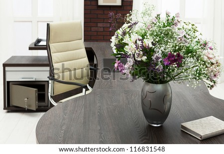 bouquet of flowers on a desk - stock photo
