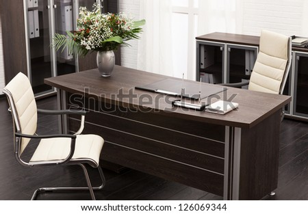 bouquet of flowers on a desk at modern office - stock photo