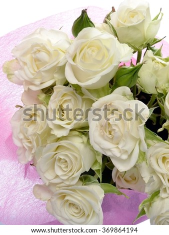 Bouquet of flowers white roses in pink wrapping paper on a white background - stock photo
