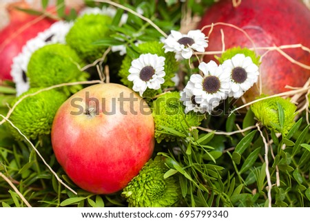 Bouquet of flowers with red apple and pomegranate