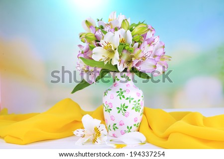 Bouquet of freesias in vase on table on natural background - stock photo