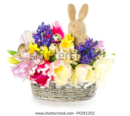 bouquet of fresh spring tulip, narcissus and hyacinth flowers with easter bunny on white background