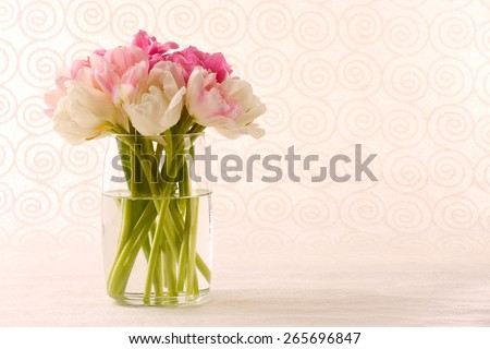 Bouquet of fresh tulips on pattern wallpaper background