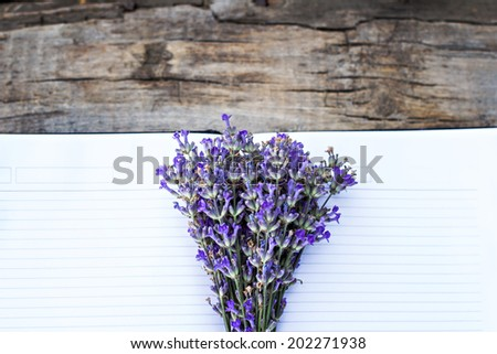 bouquet of lavender and diary on the old table - stock photo