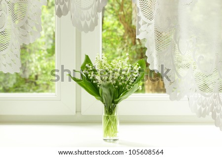 Bouquet of lily of the valley on the windowsill - stock photo