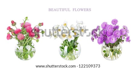 Bouquet of many beautiful multi-colored  flowers in glass vase isolated on white background