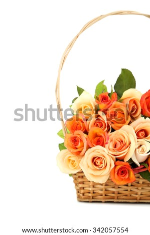 Bouquet of orange roses in basket on white background - stock photo
