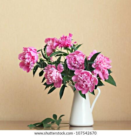 Bouquet of peonies blooms in vase - stock photo