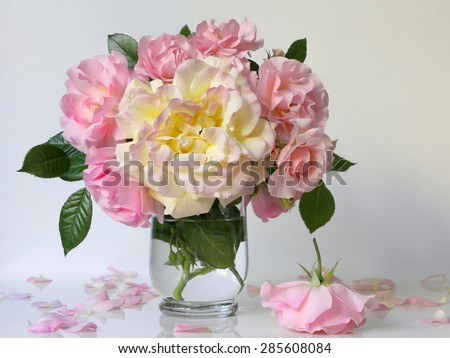 Bouquet of pink and yellow roses in a vase. Still life with bouquet of flowers. - stock photo