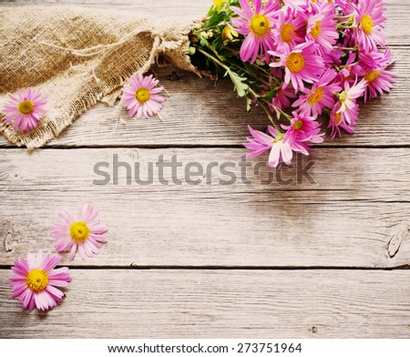 bouquet of pink flowers on wooden background - stock photo