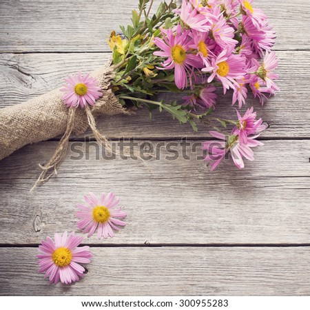 bouquet of pink flowers on wooden background