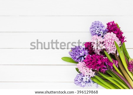 Bouquet of pink hyacinth flowers on white wooden background. Top view, copy space  - stock photo