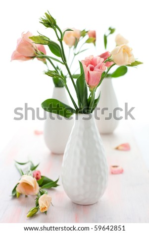 Bouquet of pink lisianthus in vase - stock photo
