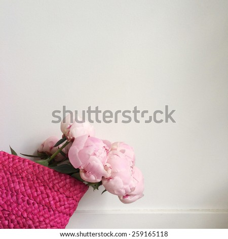 Bouquet of pink peonies in a bright pink bag - stock photo