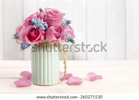 Bouquet of pink roses and blue muscari flower (Grape Hyacinth), copy space - stock photo
