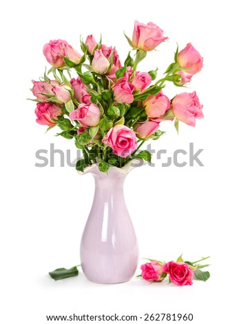 Bouquet of pink roses in a vase isolated on white background - stock photo