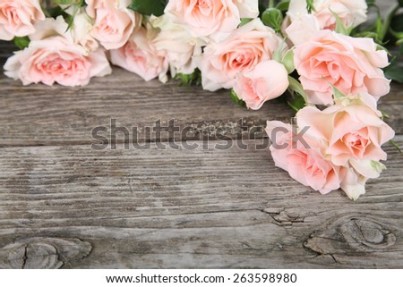 Bouquet of pink roses on a wooden background . - stock photo