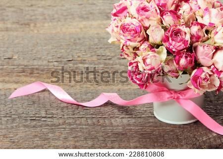 Bouquet of pink roses on white background - stock photo