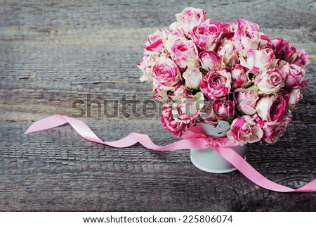 Bouquet of pink roses on white background. Image with retro filter effect - stock photo
