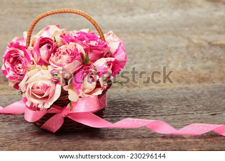 Bouquet of pink roses on wooden background - stock photo