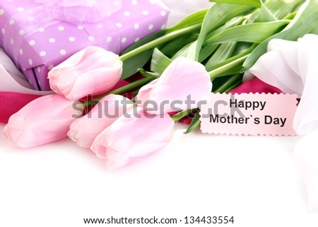 Bouquet of pink tulips and gift on cloth for Mother's Day, isolated on white - stock photo
