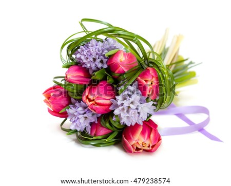 Bouquet of pink tulips and grass on green background