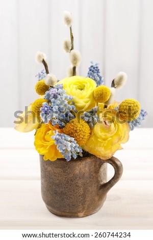 Bouquet of ranunculus (Persian buttercup) and muscari (Grape hyacinth) flowers  - stock photo