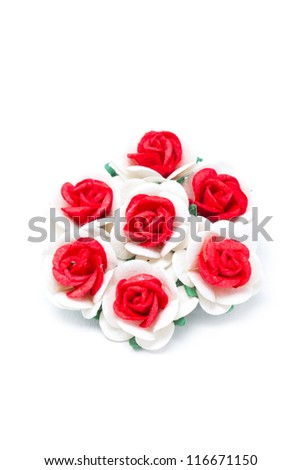 Bouquet of red and white paper roses isolated on white background.