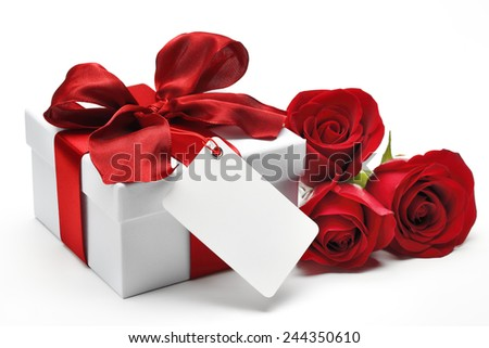 Bouquet of red roses and gift box with a blank card on white background - stock photo