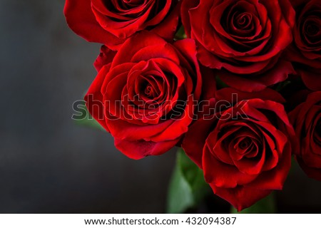 Bouquet of red roses on a black background. Top view