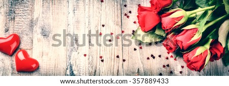 Bouquet of red roses with decorative hearts. St Valentine's concept with copy space
