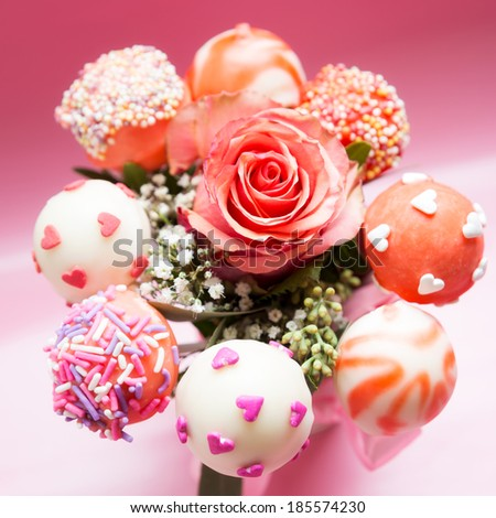 bouquet of rose and cake pops - stock photo