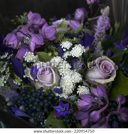 bouquet of rose, bluebells and black chokeberry - stock photo