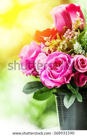 Bouquet of rose flower on blur green leaf background. Vintage filter - stock photo
